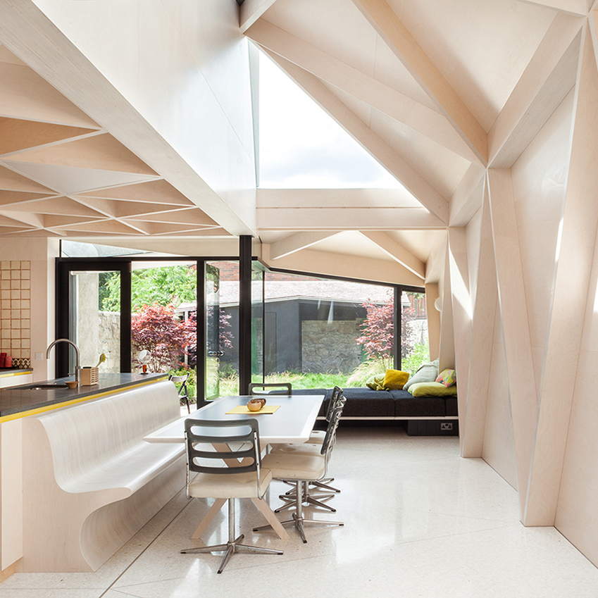 Ireland-based architectural practice NOJI Architects used plywood to create this fabulous extension, which introduces geometric patterns to a Victorian home setting. Each triangular plane is positioned to let in as much natural light as possible. The original ground floor walls have been removed, opening up the kitchen and linking it with the gardens for an indoor-outdoor feel.
