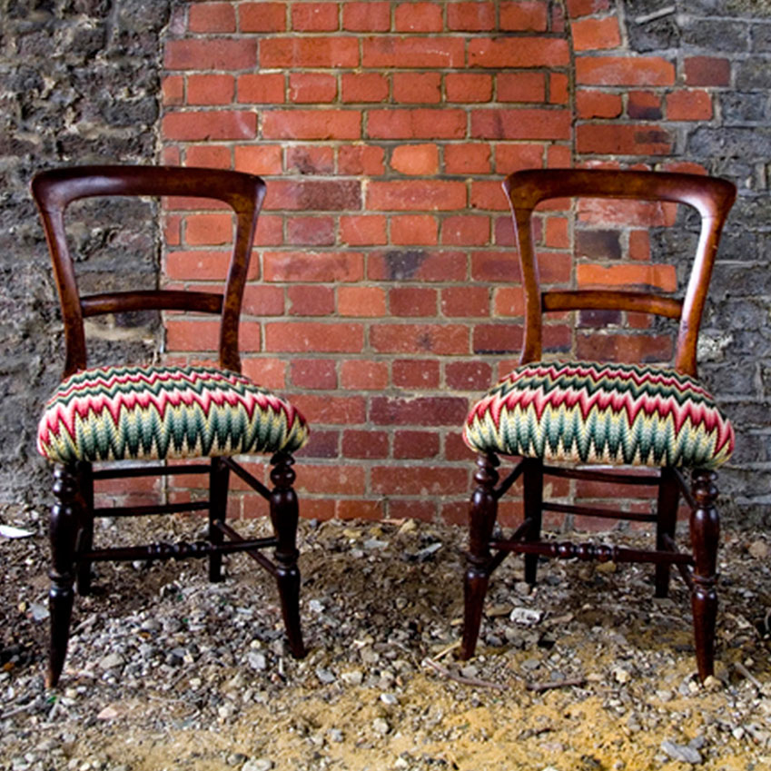 Pair of upholstered wooden chairs