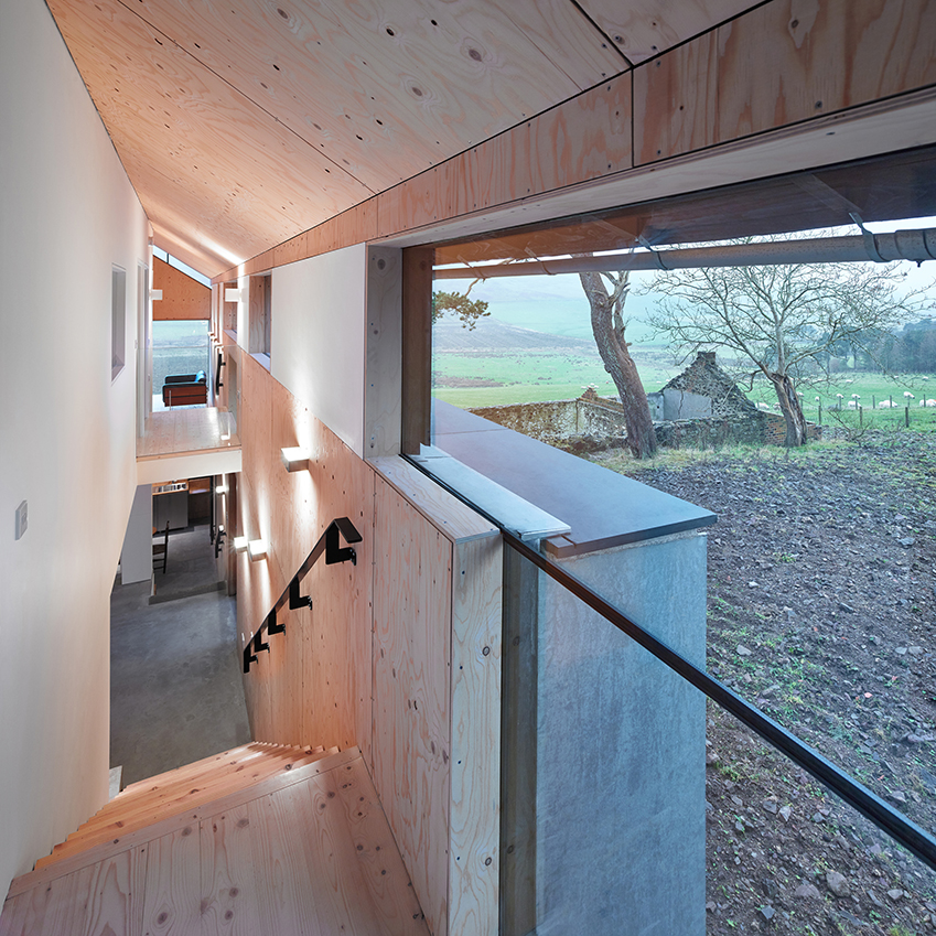 The Mill by WT Architecture, located in rural Southern Scotland, the interior features walls clad in light spruce plywood, with beautiful pine flooring to match.
