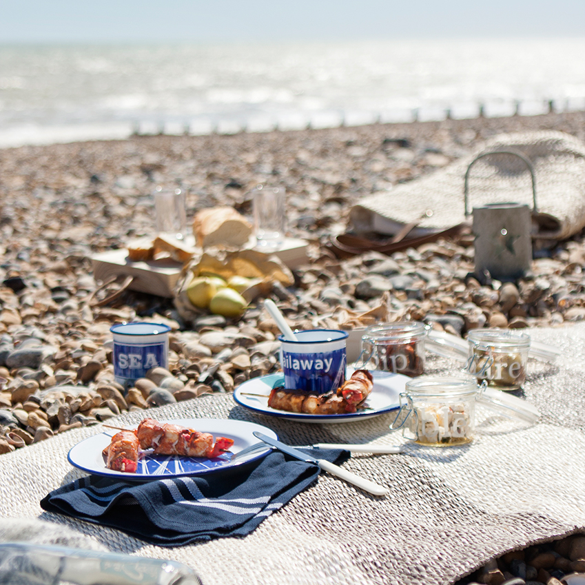 Image 1 of 4 'Pappelina Bob Mud/Vanilla' rug, from £76; plates and mugs by  Kate Samuels, from £10 for a plate; tapas jars by Garden Trading, £8.50 for a set of three; 'Lexington' blue striped napkin, £10