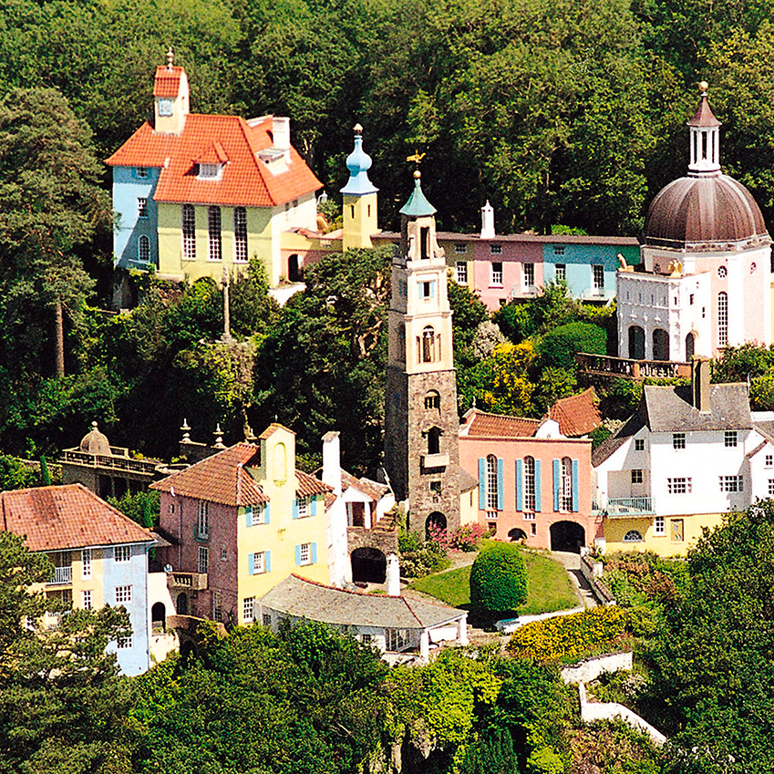 Image 3 of 8: Portmeirion is an unusual village on the North Wales coast. Designed by Sir Clough Williams-Ellis, the town is inspired by Mediterranean architecture, and resembles a village on the Italian Riviera. It is now owned by the  Ymddiriedolaeth Clough Williams-Ellis Foundation charitable trust and open to visitors.