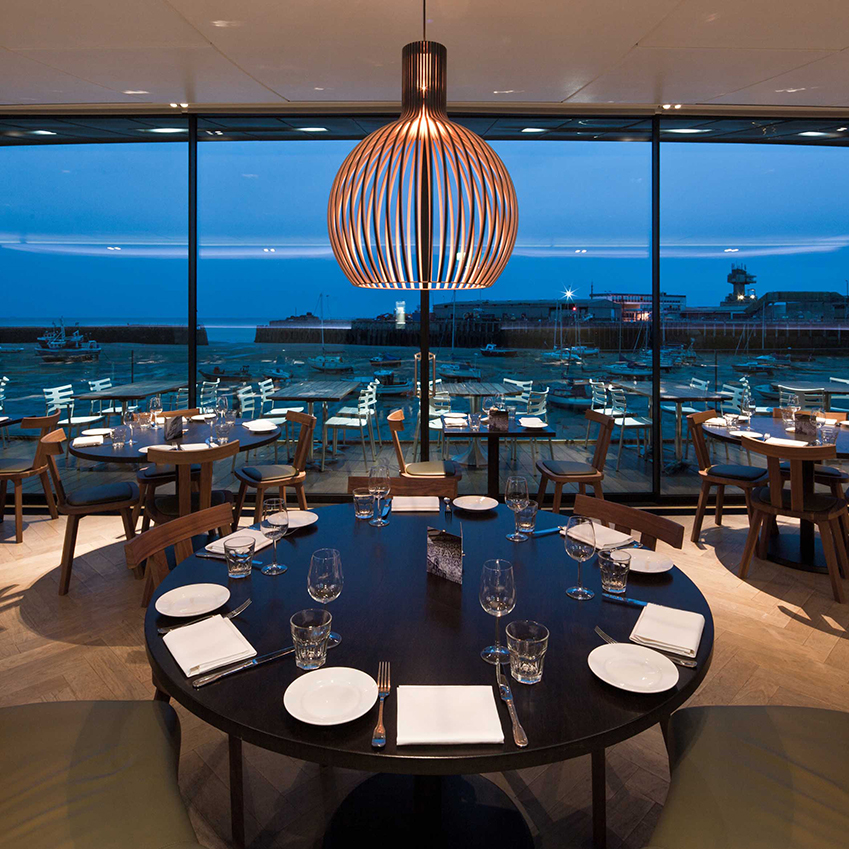 Image 4 of 8: Rocksalt is a contemporary harbourside restaurant in Folkestone owned by Michelin-starred chef Mark Sargeant. Its floor-to-ceiling windows, marble frontage and fresh, seasonal fare sets it apart from the rest