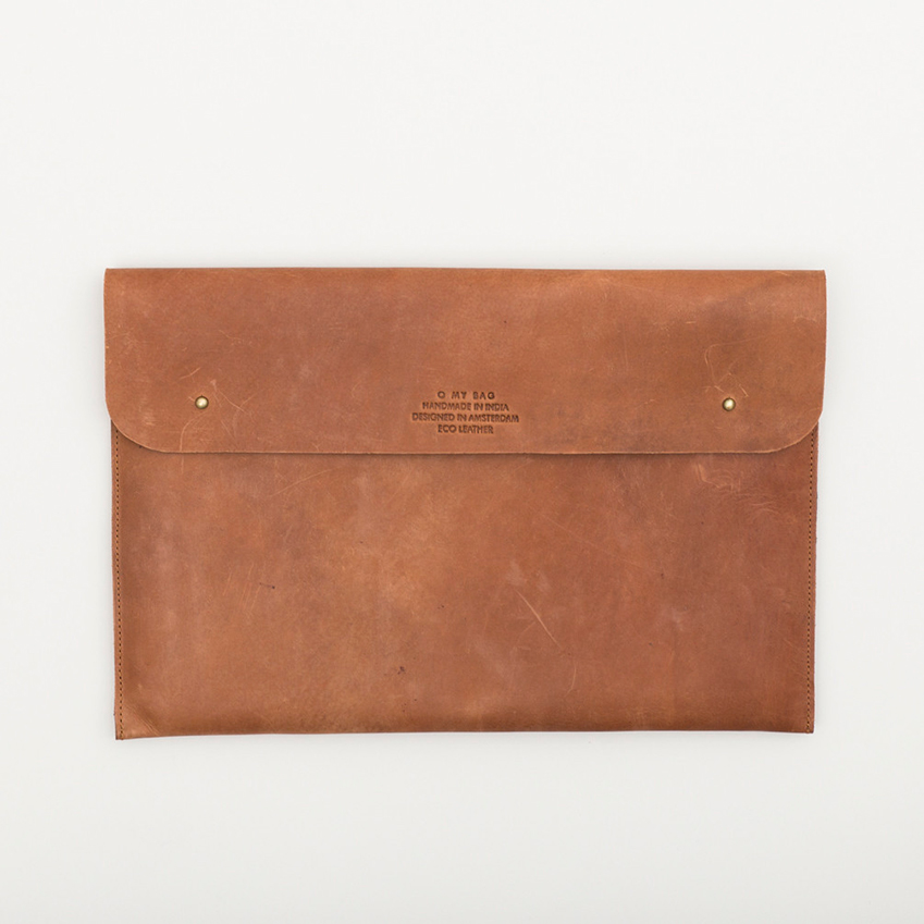 When craft meets technology: Leather laptop sleeve by O-My-Bag, £68, Such and Such