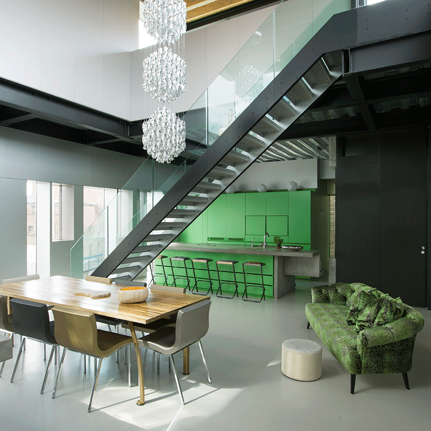 Here, a bright green kitchen and complementary-coloured sofa are an engaging bolt of the healthy hue. Photographer: Henrik Knudsen
