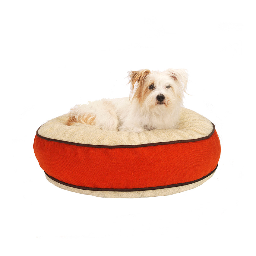 'Edison' Harris Tweed orange dog bed, £245, Love My Dog (lovemydog.co.uk)