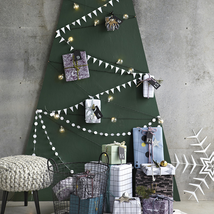 House Doctor – Use forest-green wrapping paper to create your base, then accessorise with paper garlands, decorations and cards.