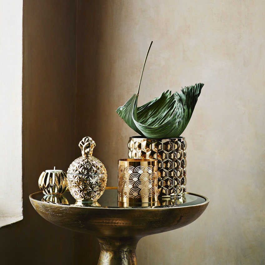 Tealight holder £2.99; Pineapple candle £4.99; Gold cut-out candle holder £3.99; Plant pot £12.99
