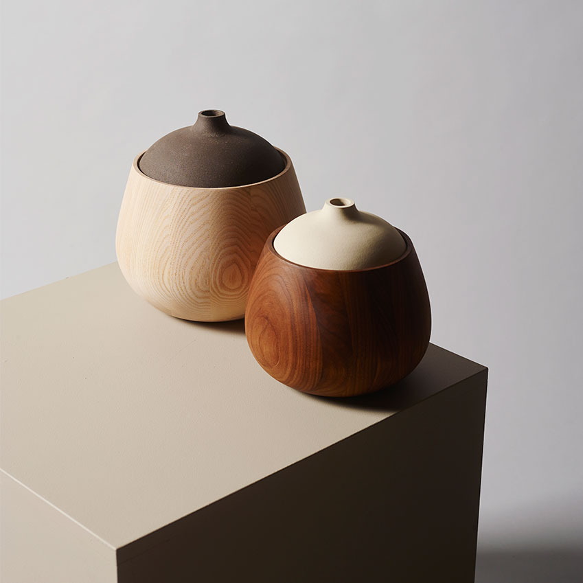 'Hegne' (2015) containers in turned ash and ceramic by Kristine Bjaadal