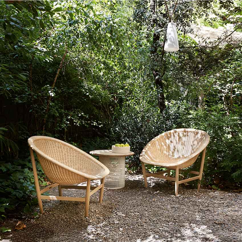 'Basket' armchairs by Nanna and Jørgen Ditzel, £1,845; 'Mesh' side table by Patricia Urquiola, from £590, all Kettal (kettal.com)