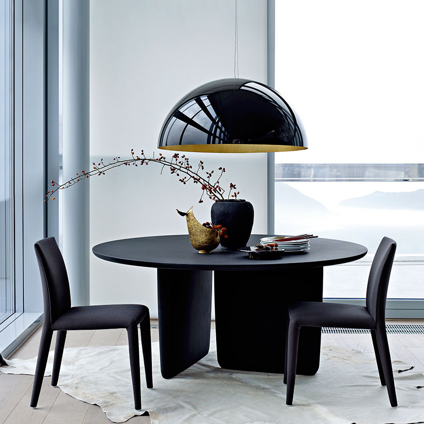 The black lacquered Tobi-ishi table by Barber Osgerby for B&B Italia