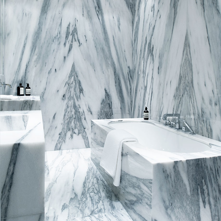 Carrara marble bathroom by Laura Gonzalez